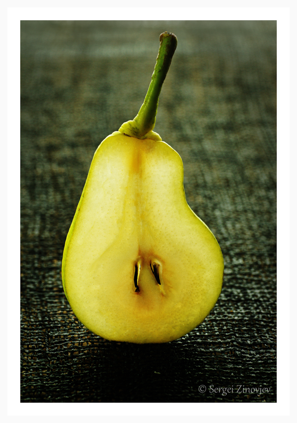Slice of pear on the dark background