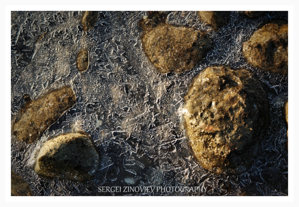 stones in the frozen water