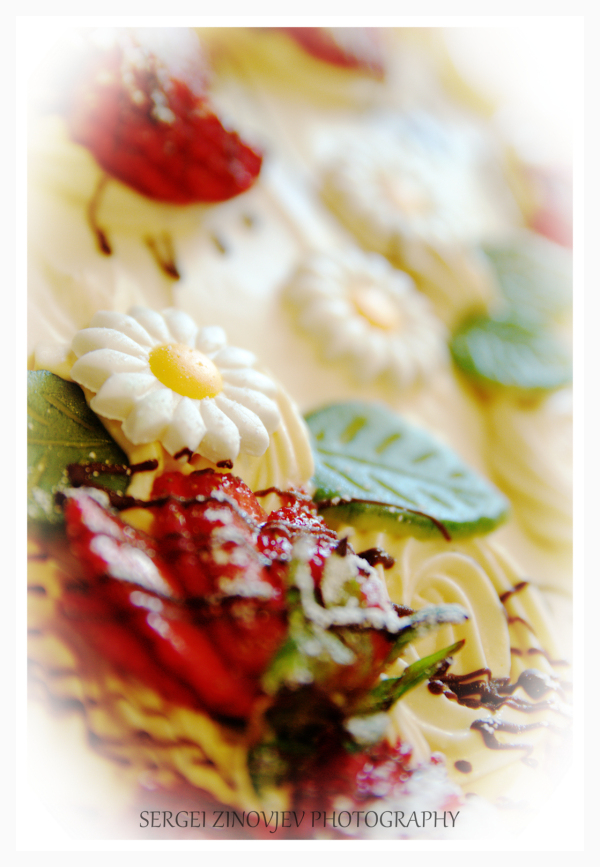 cake decorated with marzipan and strawberries