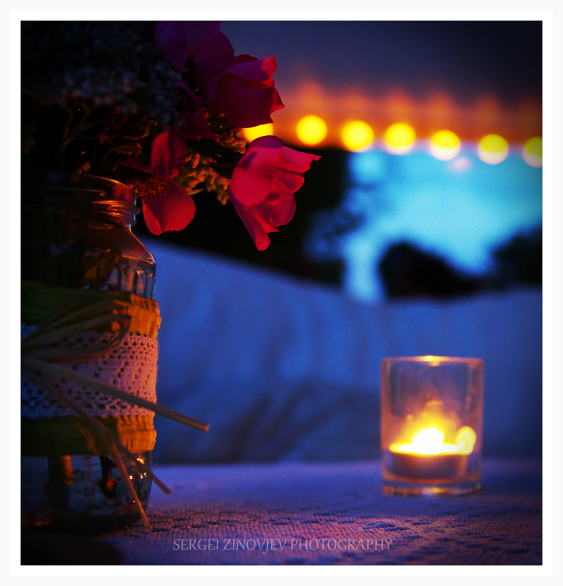 candle and bouquet on the table