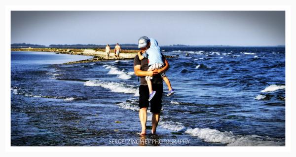 man holding a boy