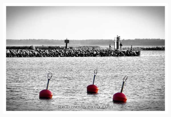 Three red buoy in the water