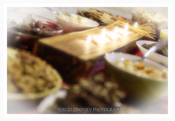viriety of food on the table with candle light