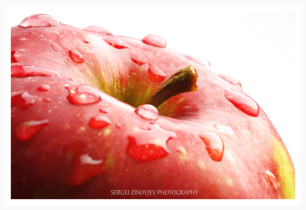 fresh red apple covered with water drops