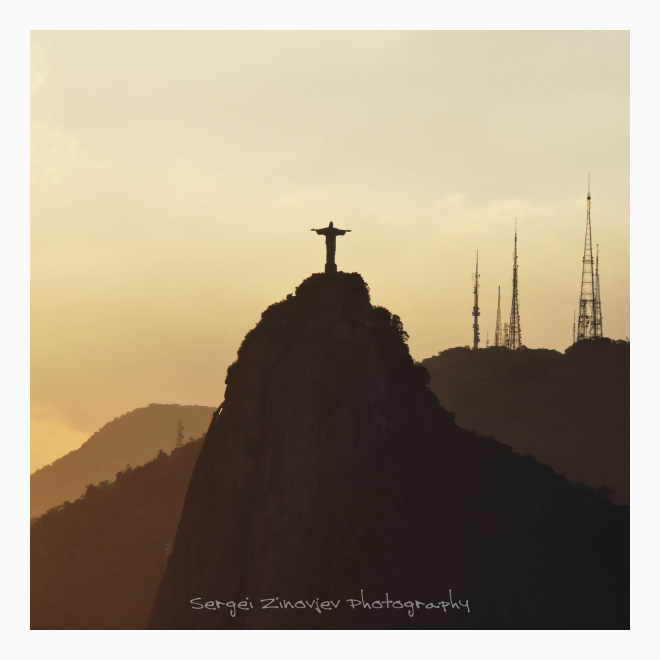 Statue Christ the Redeemer in golden evening light