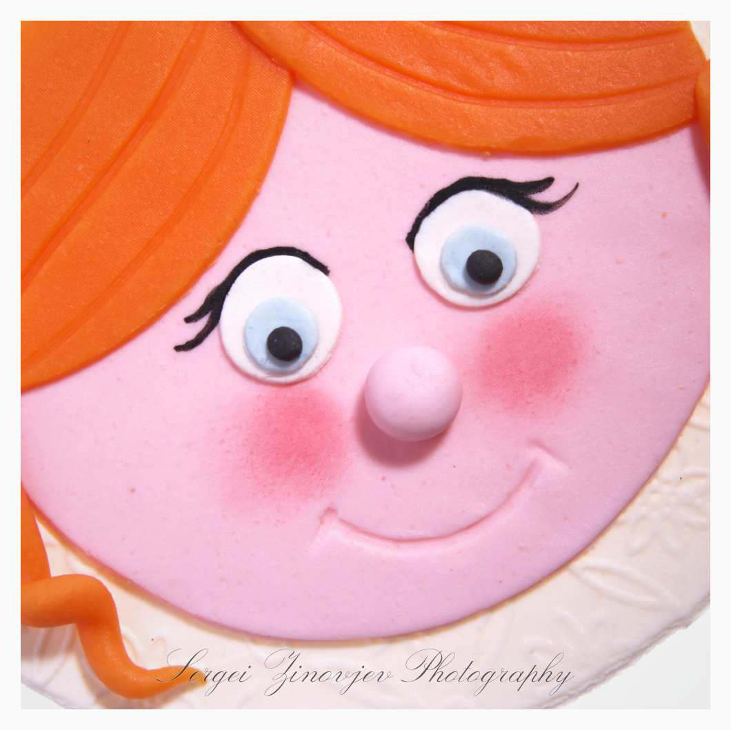 close-up of girl's face made of marzipan