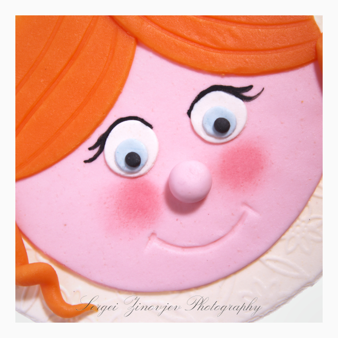 close-up of girl's face made of marzipan