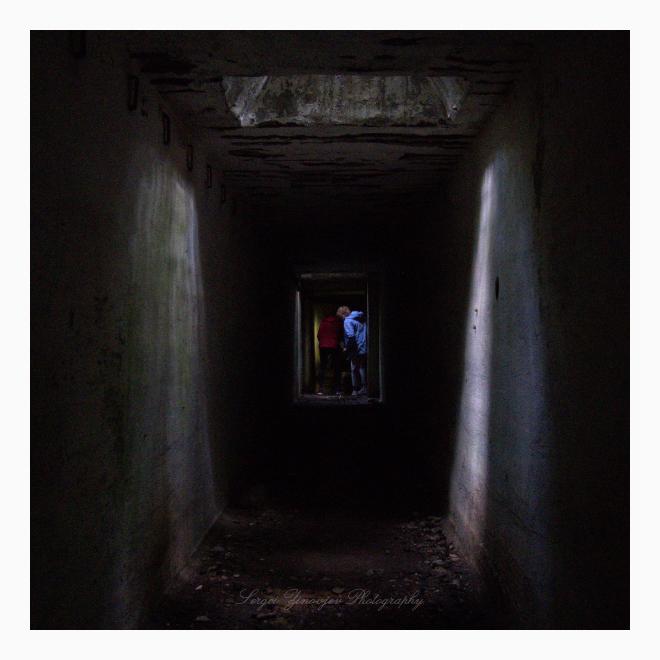 people in dark tonnel