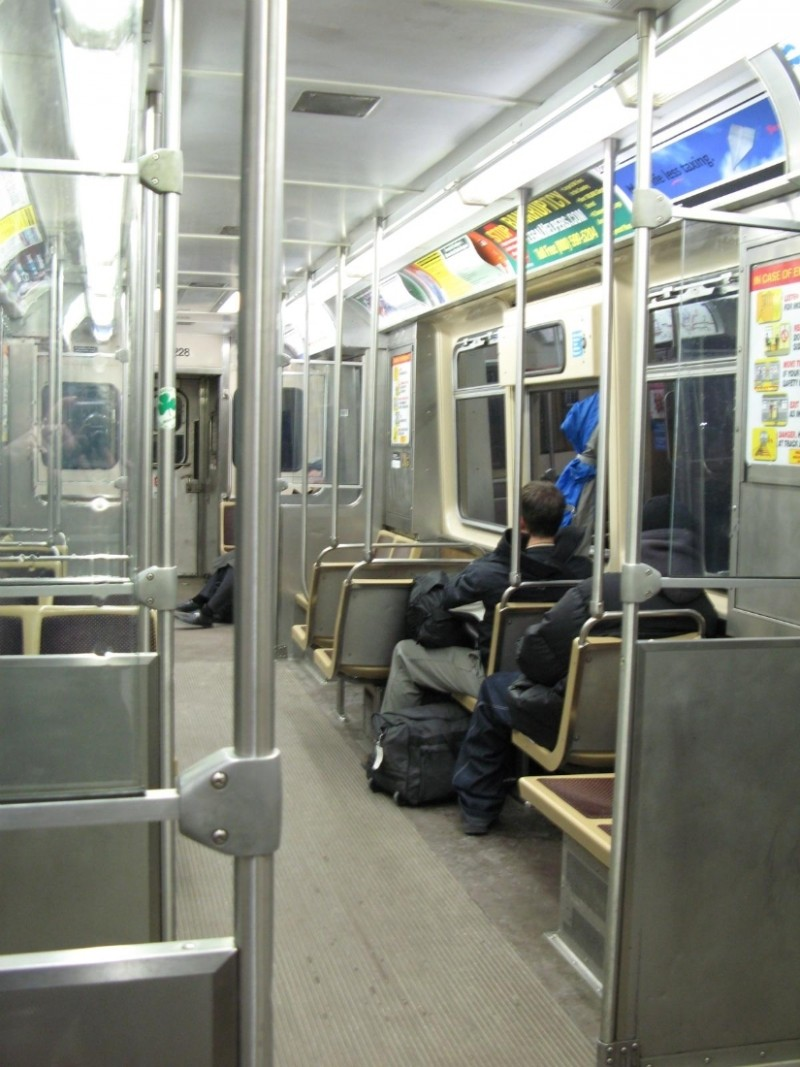 On the El, far too early, going to Midway Airport