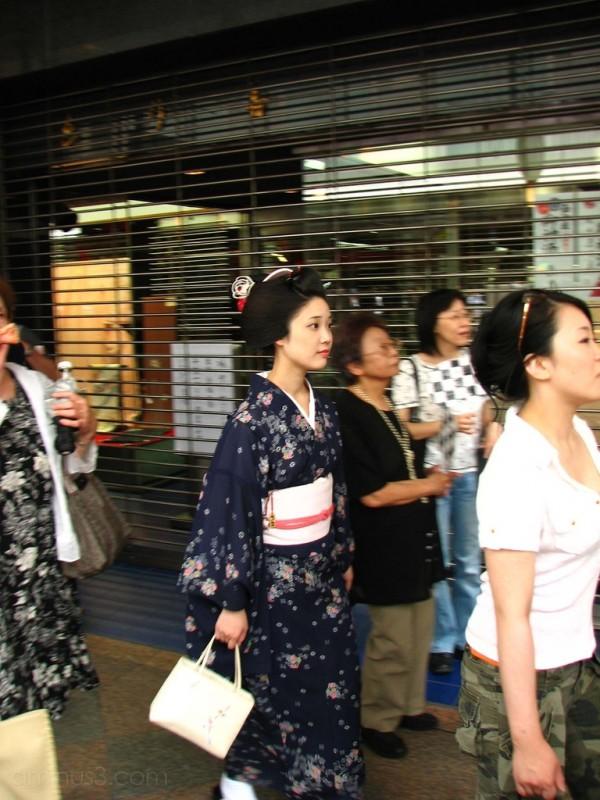 A maiko walking down Shijo street