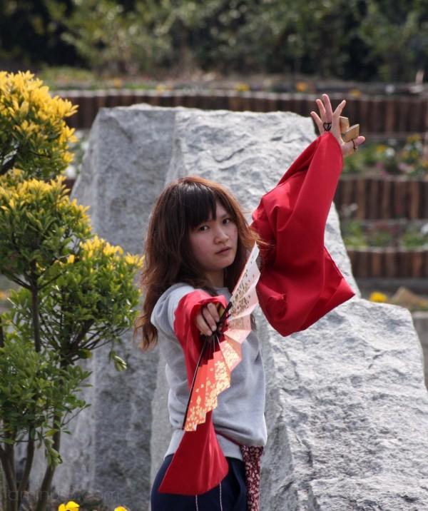 A girl doing fan dancing in Umekoji Park