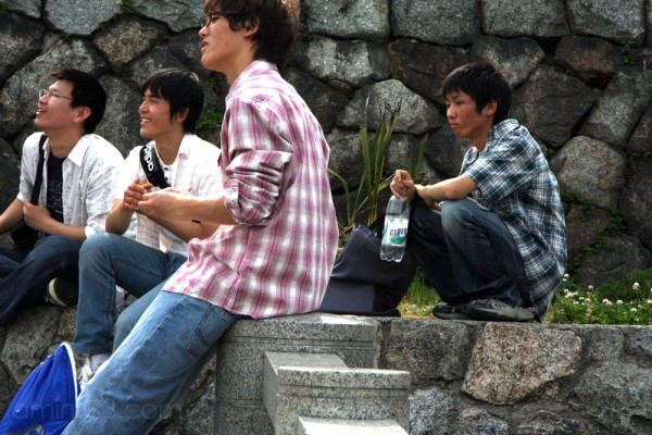 Kids hanging out along the Kamo