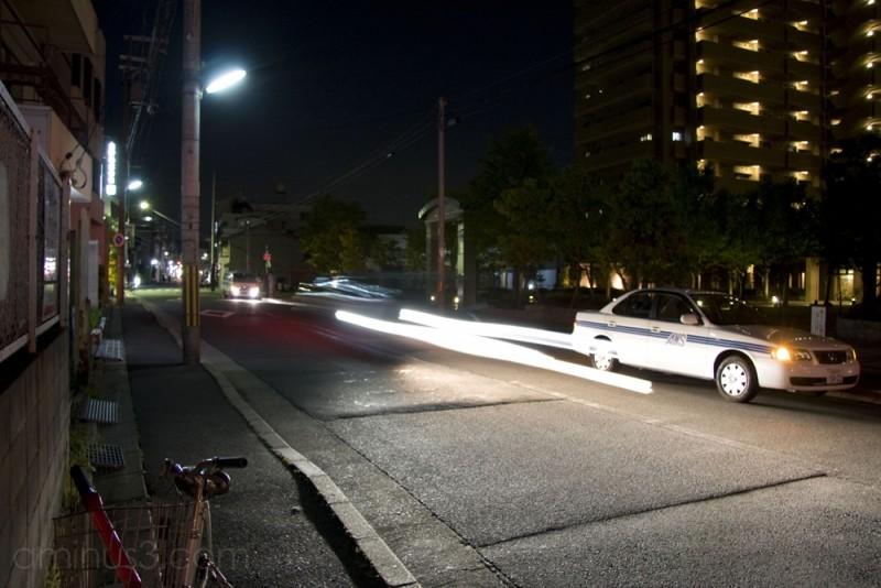 Some headlights streaking through the night