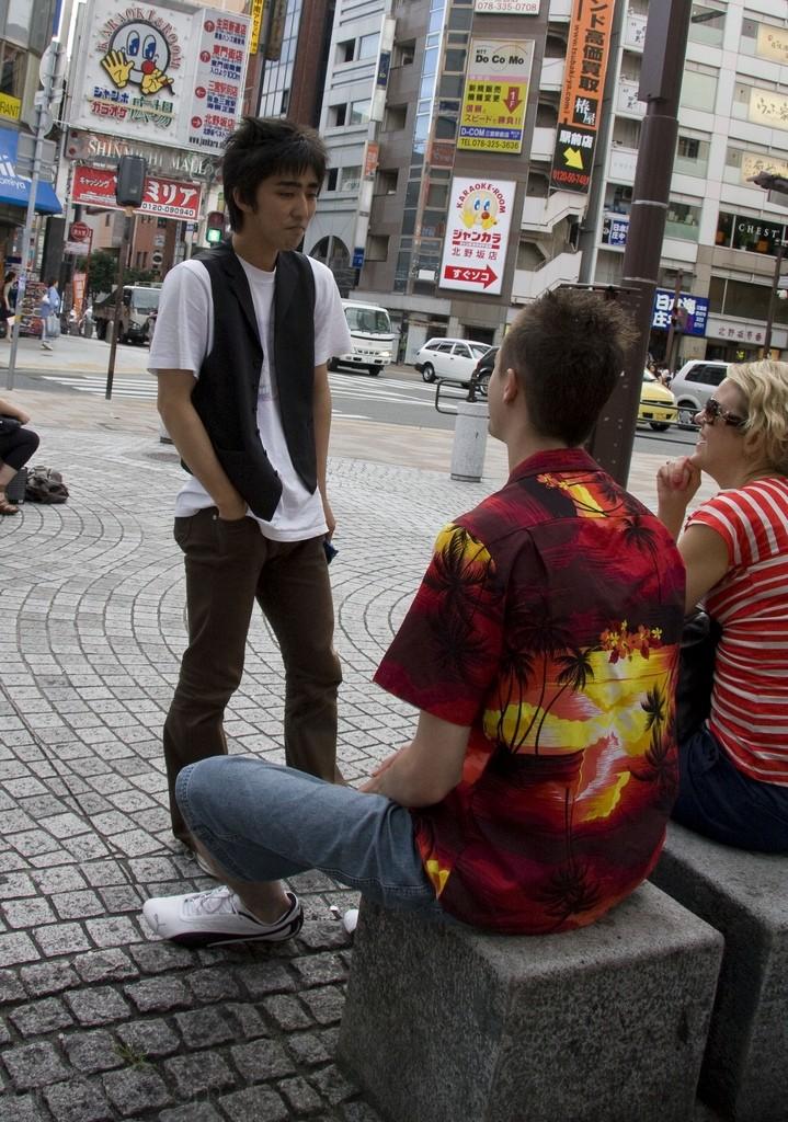 Greeting tourists in Sannomiya
