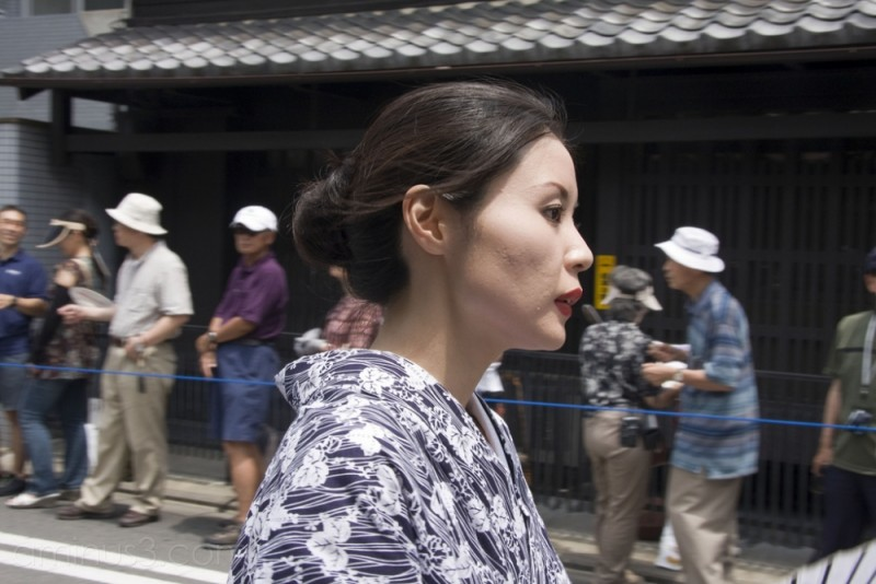 A woman walking down Shinmachi