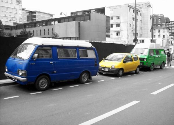 Three cars in a Parisian neighborhood