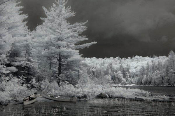 An infra red shot of Canoes with stormy sky