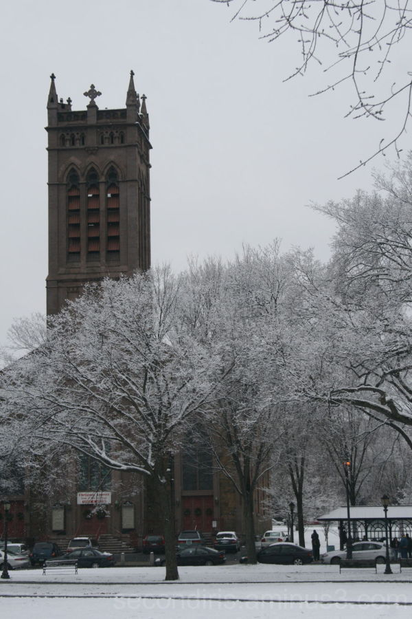 The church stands tall against the beating snow