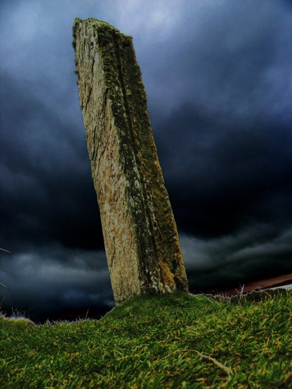 A standing stone strikes the stormy Orkadian sky..