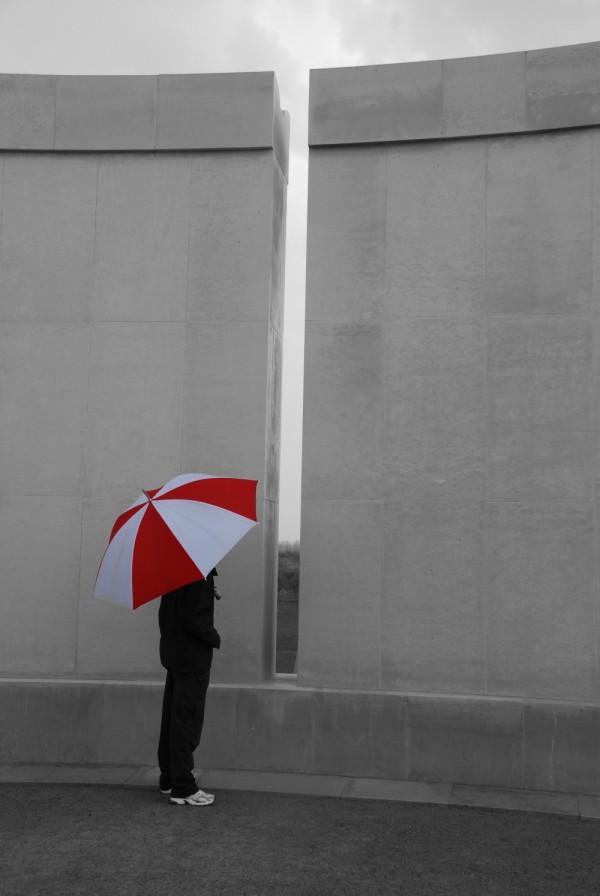 An umbrella by a memorial