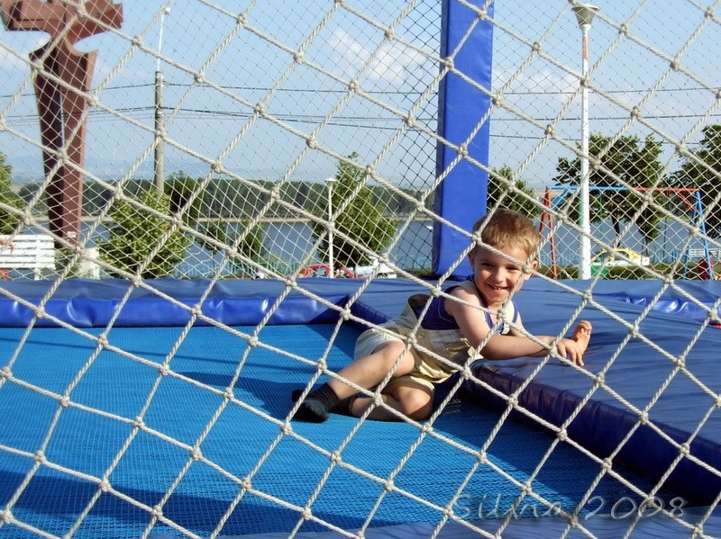 Child in a jumping net