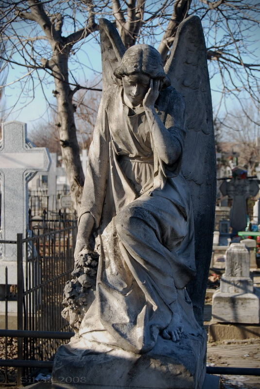 Angel sculpture on a grave yard