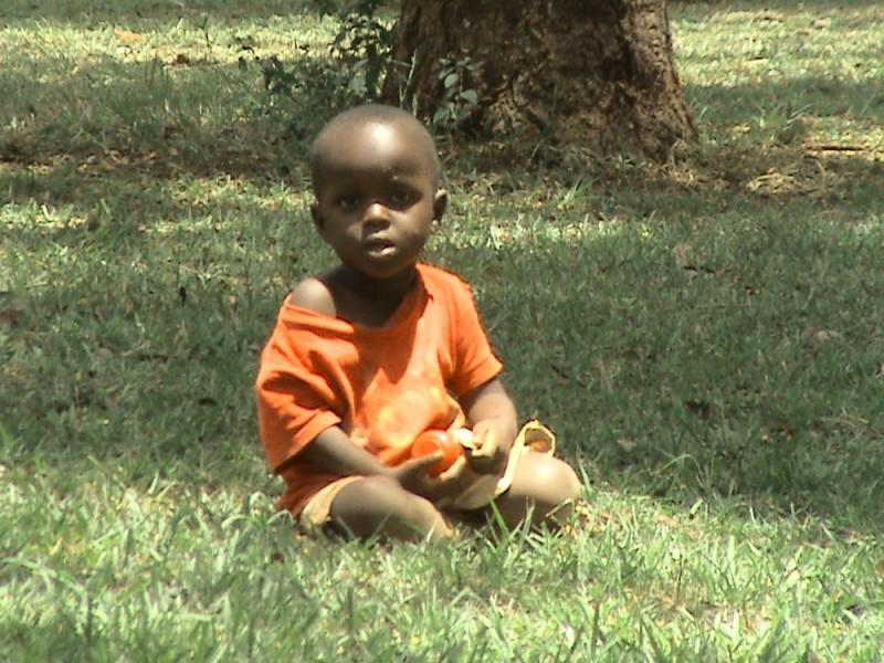 Boy on grass in Lugasi schoolground