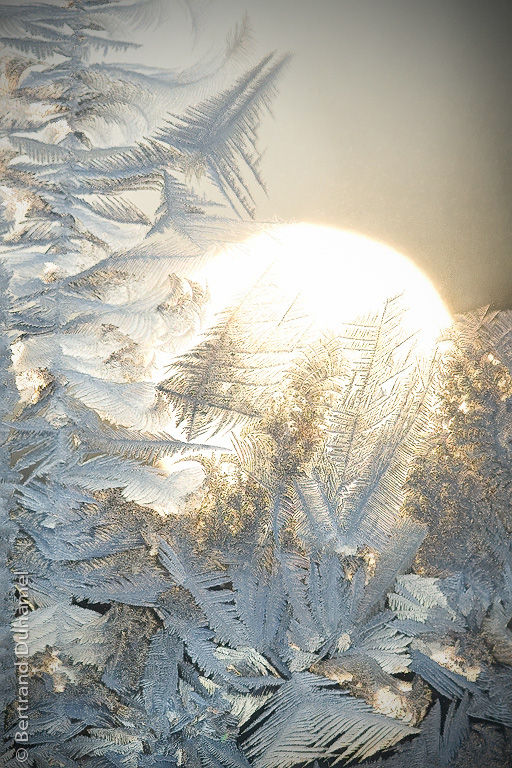 Icy wonderland... A sunrise behind a frosty window