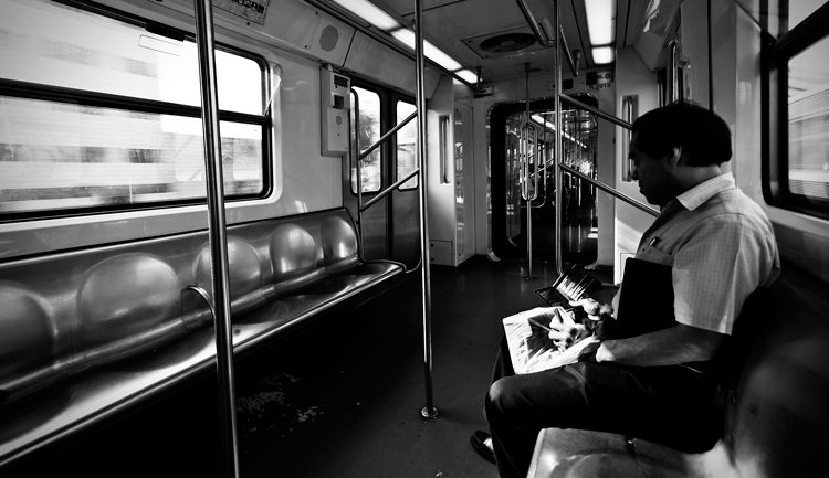 Lone rider on Metro.