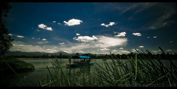 Boat, sky, and lake at Xochimilco, Mexico City.