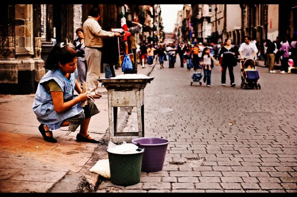 A woman prepares for a day of street vending.