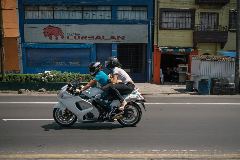 A guy and his gal along Tlaplan, Mexico City.