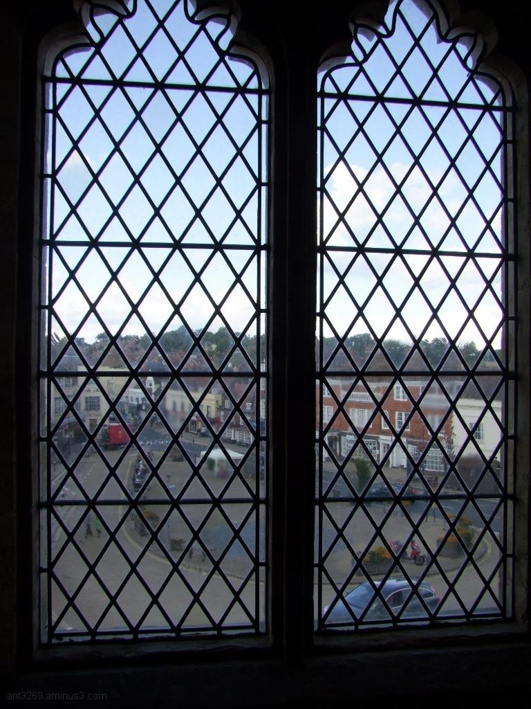Through the window.