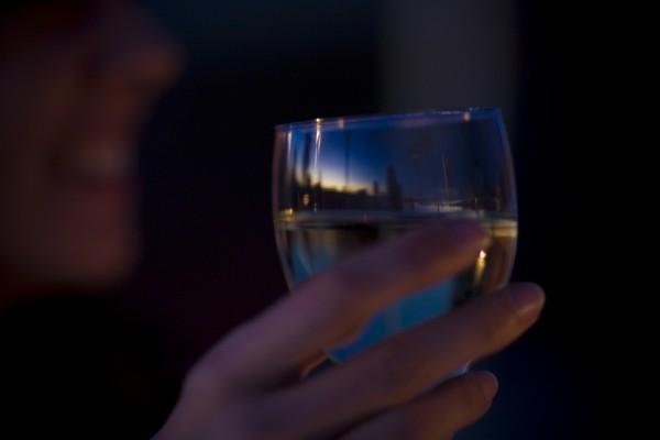 Reflection of sunset at Uluru through a wine glass