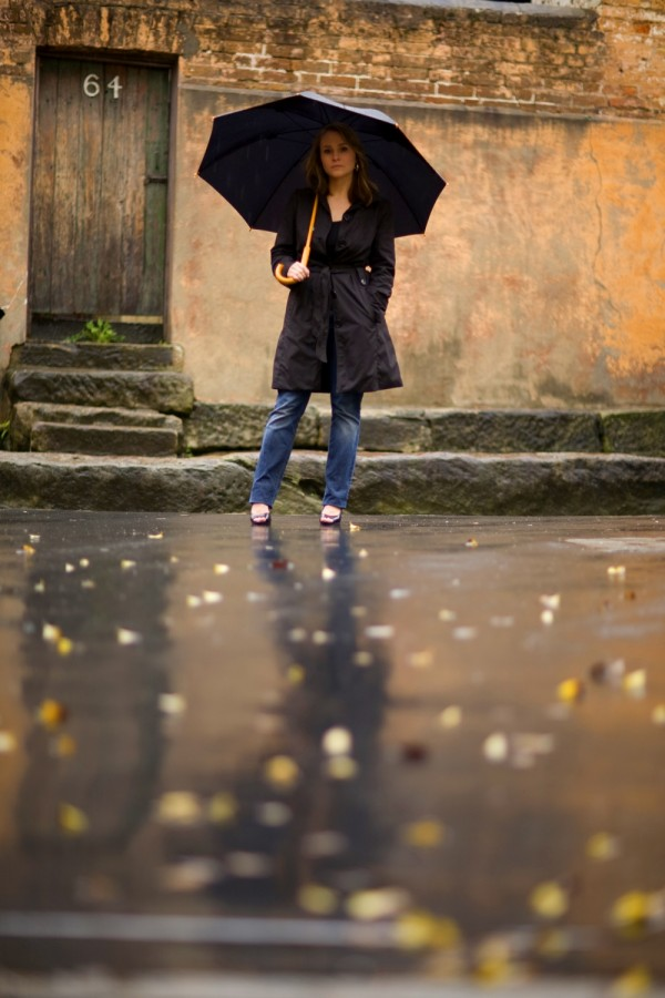 Woman standing in the rain with umbrella 2