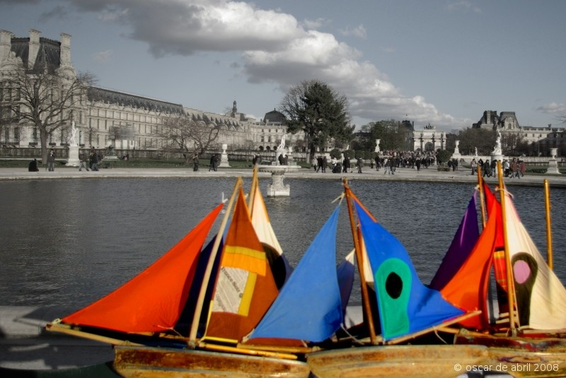 colorfull sails and grey ancient building