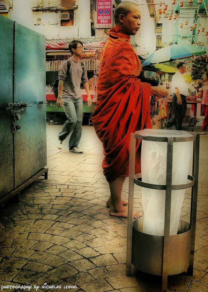A monk asking for donation in the street