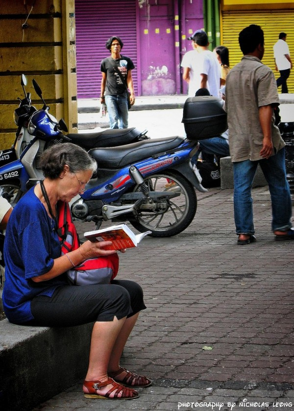 Lady reading on the streets