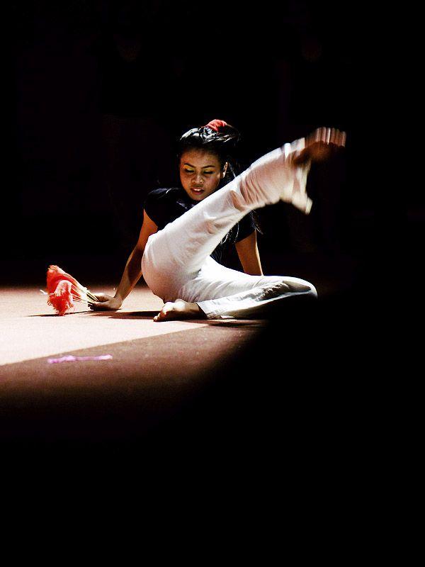 A dancer swirling kick