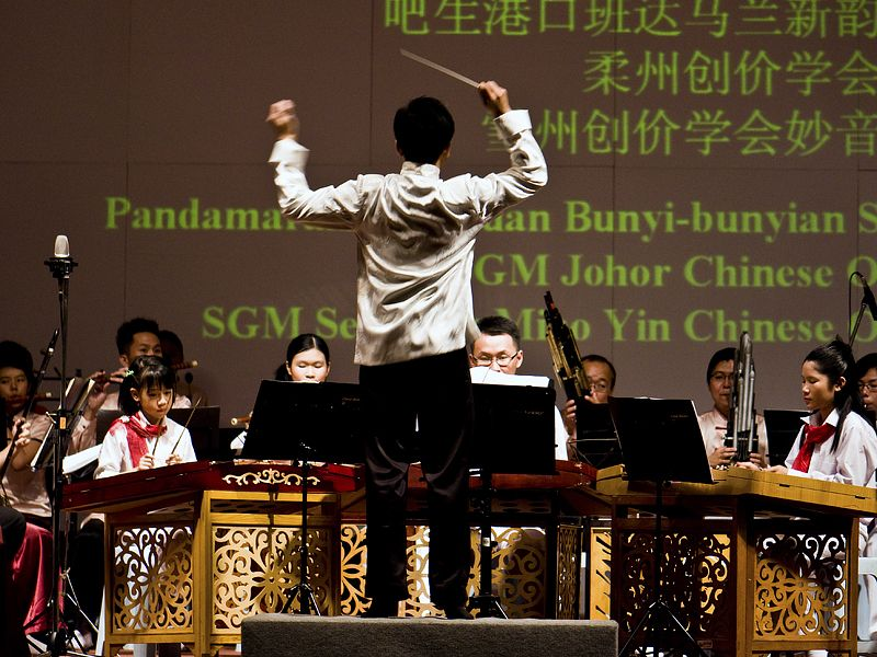 Picture of a conductor during a Chinese orchestra