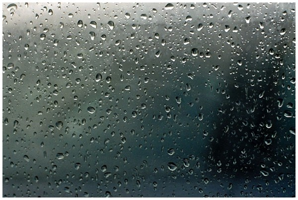 Raindrops over a car window
