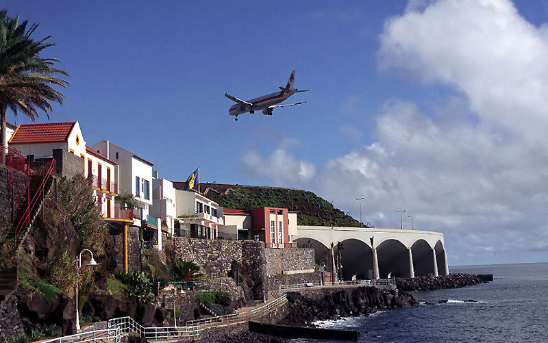 Airplane in final approach to Madeira Airport