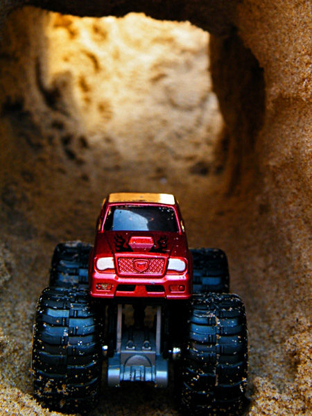 Monster truck on a tunnel made of sand