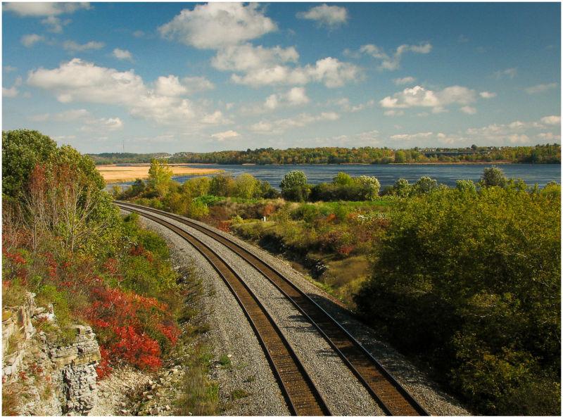 train tracks bend into the autumn colours.