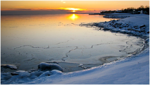 Sunset reflect in icy Lake Ontario