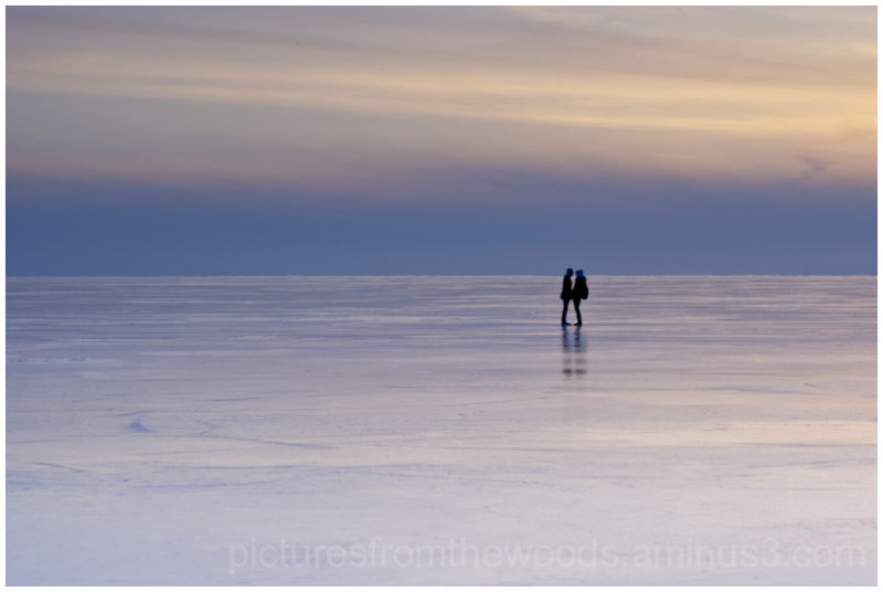 A couple share a moment on frozen lake.