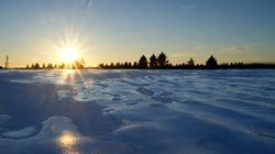 A winter sunset over fields of ice.