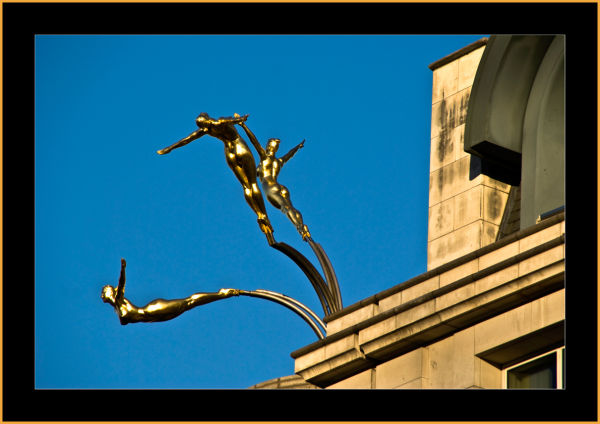 The top of a building in Picadilly Circus, London