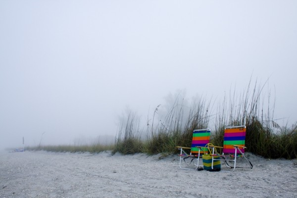 Beach chairs in the fog