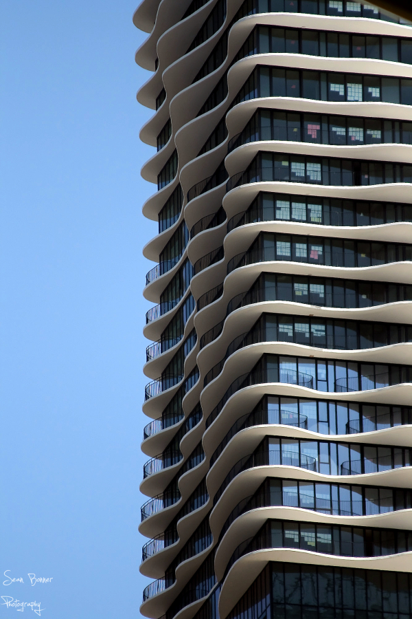 up close picture of a wavy building in chicago